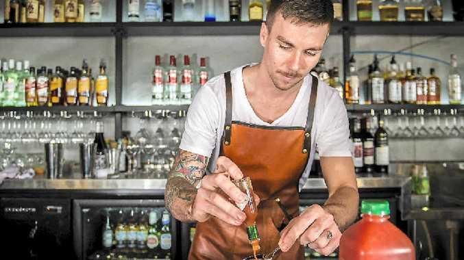 MASTER MIXER: Nick Partridge creating at Lightbox Espresso and Wine Bar on Goondoon St.
