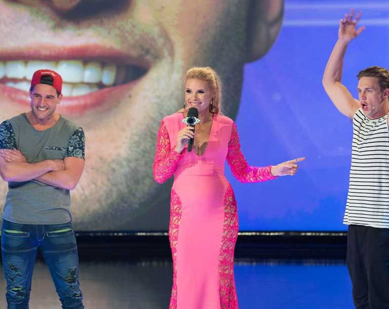 Host Sonia Kruger tells Travis, left, and Ryan they will compete as a pair.