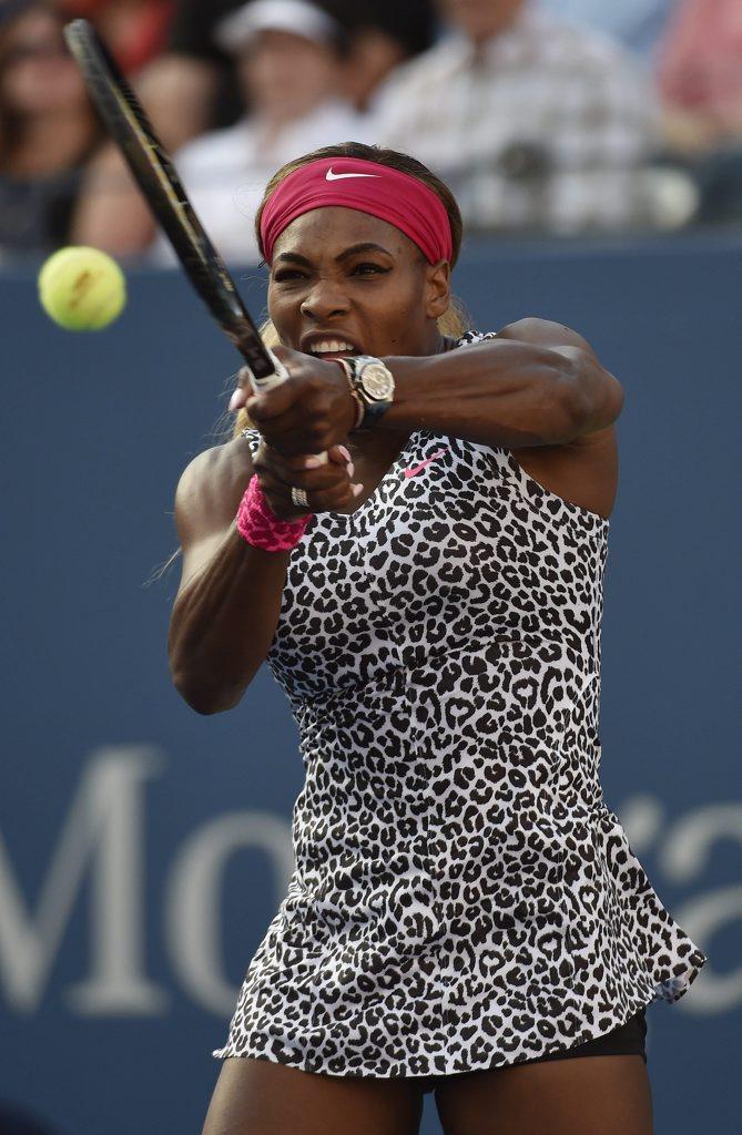 Serena Williams of the US hits a return to Caroline Wozniacki of Denmark.