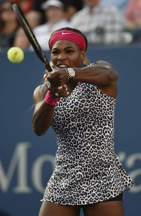 Serena Williams of the US hits a return to Caroline Wozniacki of Denmark.