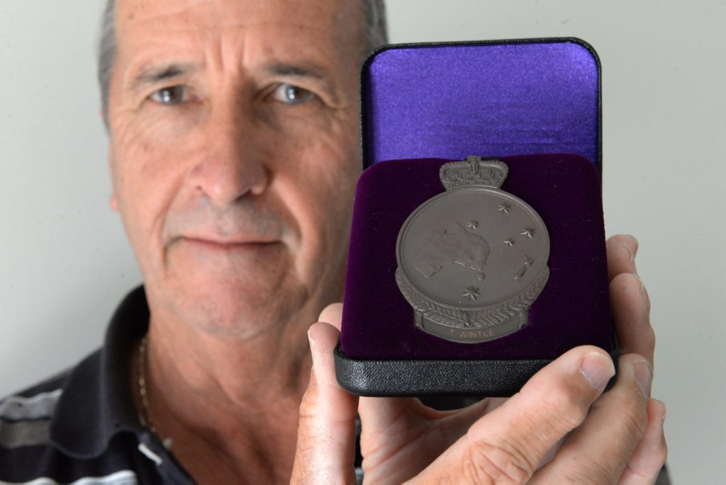 ROLL OF HONOUR: Graeme Rodgers holds his great uncle Thomas Wintle's First World War medal. Thomas Wintle's name has been added to the Australian War Memorial in Canberra. Photo: Mike Knott / NewsMail