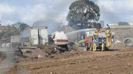Firies battle a fire at a Toowoomba transport business.