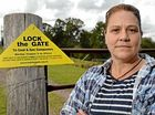 Residents lock the gate on coal