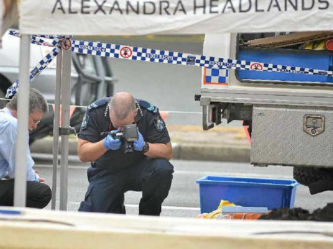 FORENSIC FALSE ALARM: Police examine bones found by roadworkers at Alexandra Headland.