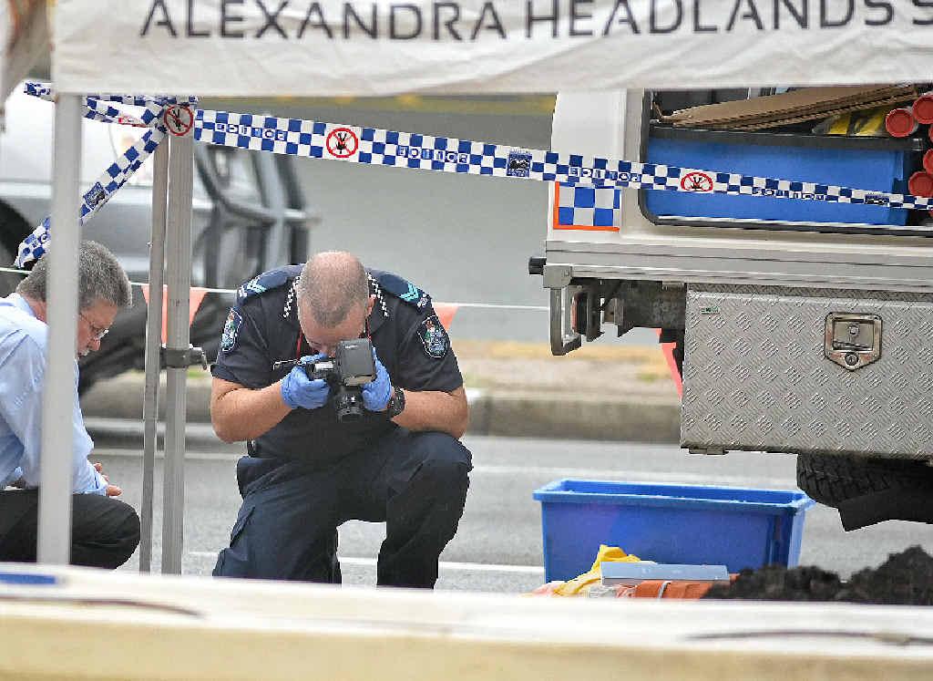 FORENSIC FALSE ALARM: Police examine bones found by roadworkers at Alexandra Headland.