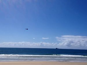 Helicopter at shark attack scene