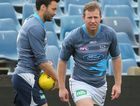Steve Johnson and Jimmy Bartel of the Cats stretch during a Geelong Cats AFL training session.