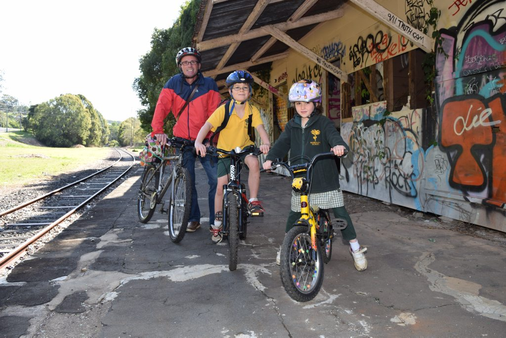 RAIL TRAILERS: Secretary of the Northern Rivers Rail Trail Group Inc, Peter Martin with his children Jackson and Leita at Bangalow Station.