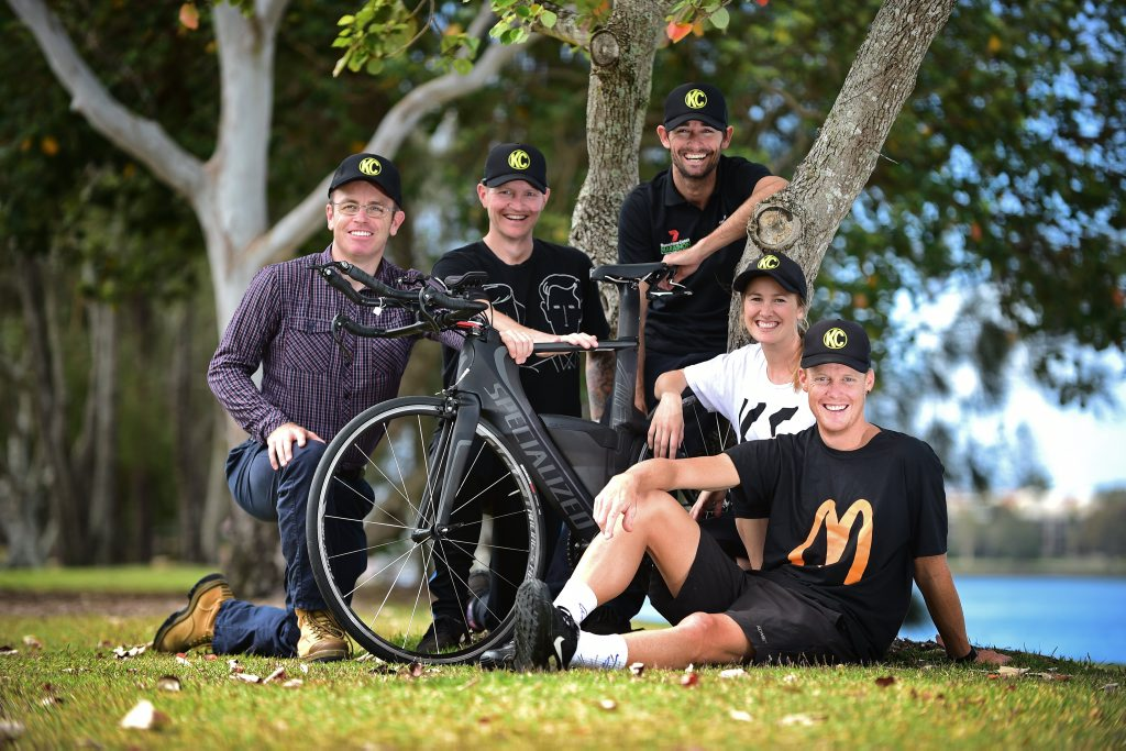 Triathlete Casey Munro of Mooloolaba(front right) readies himself for this weekend's 70.3 event with support crew (left) John Smith, Nathan Shearer, Jason Crowther and Bernadette Bridger. Photo: Iain Curry / Sunshine Coast Daily