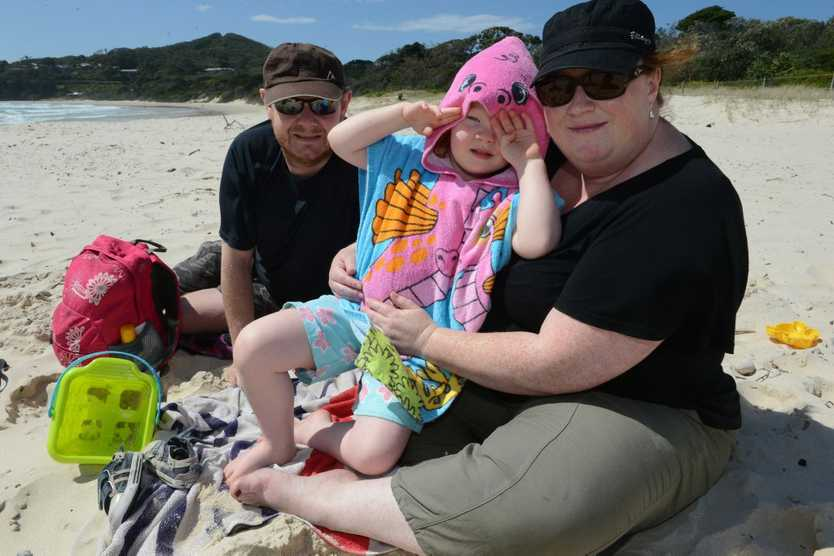 Holidaying in Byron Bay are, from left, Tony, Grace, and Jacquie Tilbury, (and sleeping Rory obscured) from Melbourne.