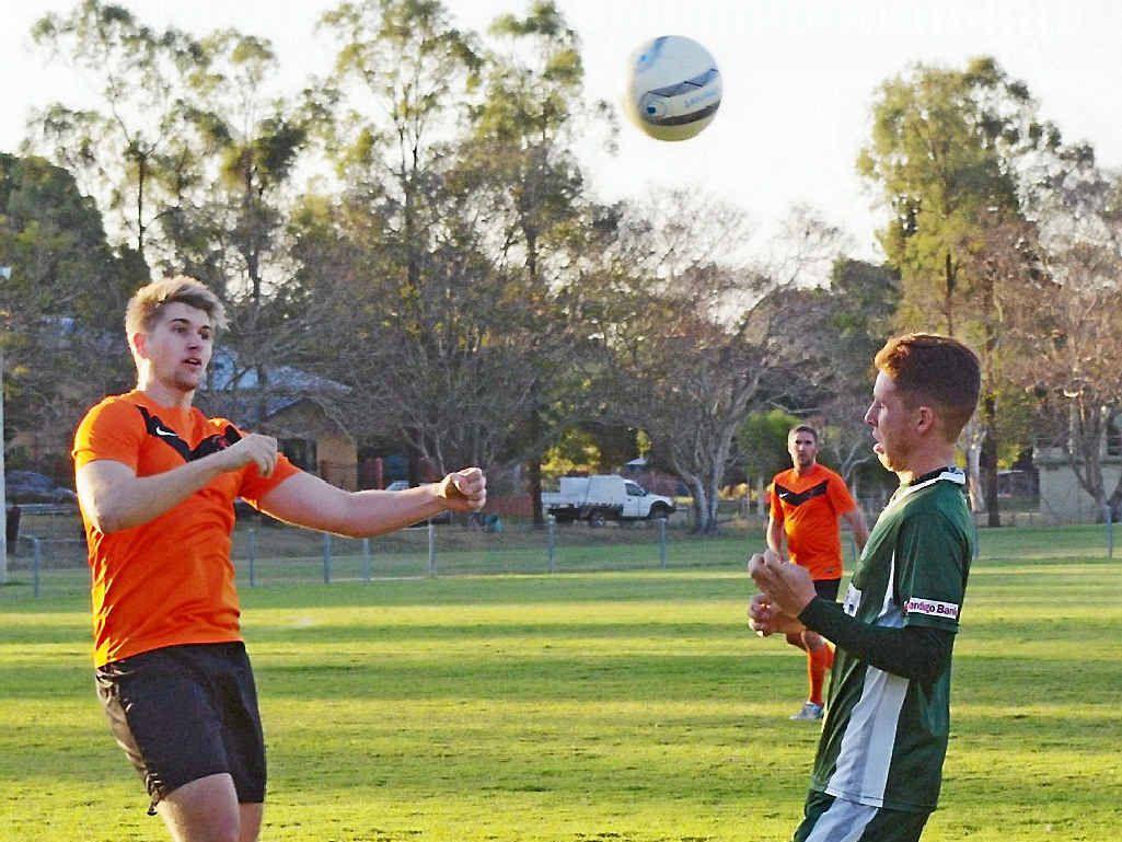 ROCK SOLID: Matt Ousten heads the ball against Frenchville.