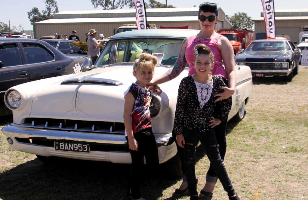 Bec Brennan, with her daughters Mia Callum and Tahlia Brennan, in front of her 1953 Mercury.