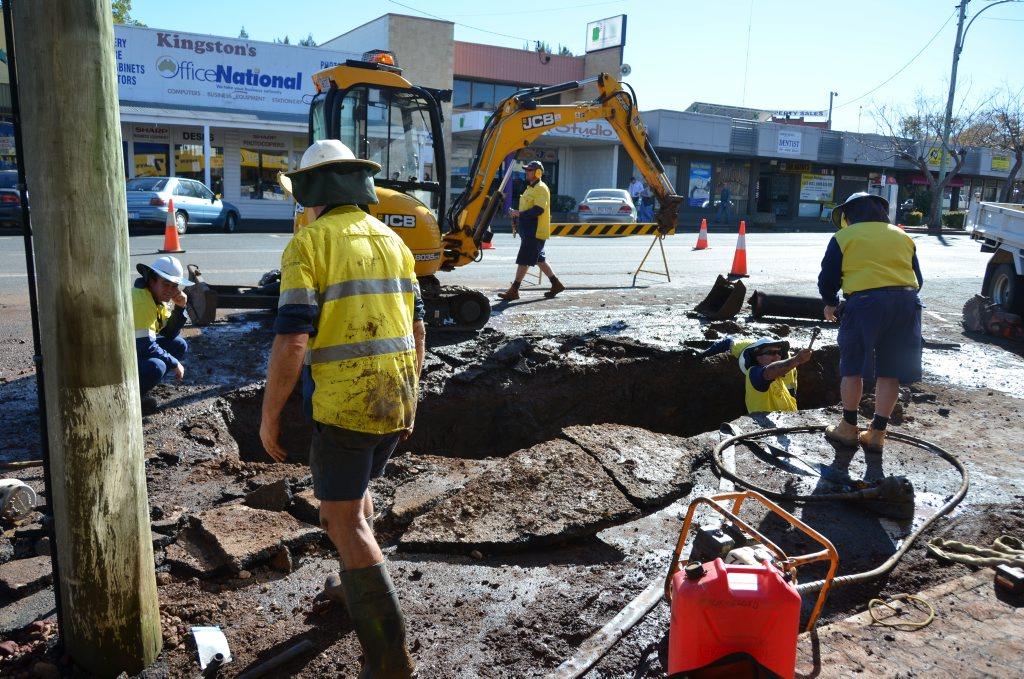 DUG UP: Construction workers repair a broken water main on Haly Street. Photo Keagan Elder / South Burnett Times