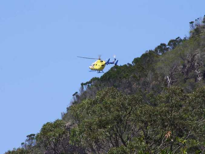 The RACQ CareFlight Rescue in action on Friday off Mt Coolum.