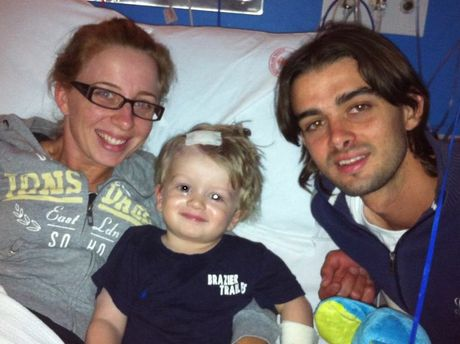 Kirsten Kay and Clinton Rayner with their son Braxton Rayner after he had brain surgery.