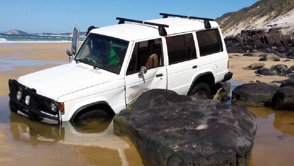 DROWNED: A Mitsubishi Pajero was flooded after it became trapped at Mudlo Rocks on Wednesday night. Crews recovered it Thursday morning.