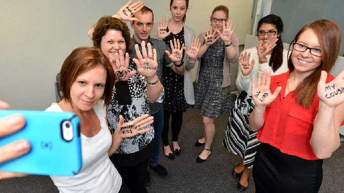 Mackay Base Hospital psychologists Rachel Bega, Desley Stehbens, Peter Senyard, Beau Zelenka, Sara Spillman, Jo Loader and Leishan Hughes support White Balloon Day's selfie campaign, to encourage protection of children from abuse.