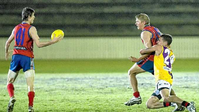 YOUNG TALENT: Warwick's James McKendry (left) and Tim Tate tackle Bombers' Jeremy Crow in this season's AFLDD competition.