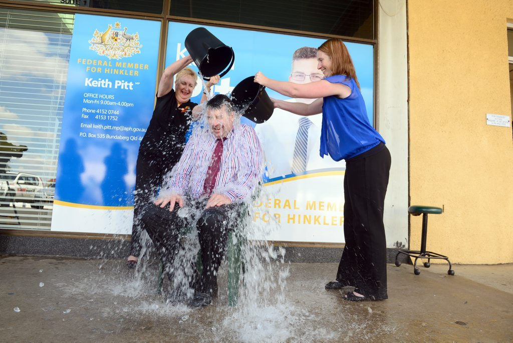 ICE BUCKET: Member for Hinkler Keith Pitt takes the ice bucket challenge and 4BU's Trish Mears and the NewsMail's Liz Carson gladly step in to help. Photo: Max Fleet / NewsMail