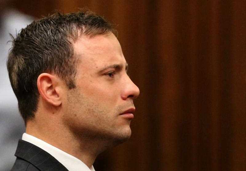 As Pistorius stood impassively in the dock with his hands folded in front of him, Judge Thokozile Masipa read out her verdict, which could carry a sentence of up to 15 years in prison.
