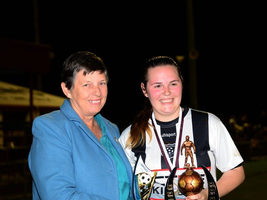 2014 WINNER: Kim Tominich presents Bingera captain Madelyn McCracken the Division 1 premiership trophy at Martens Oval after beating Moore Park 2-1. Photo: Ben Turnbull / NewsMail