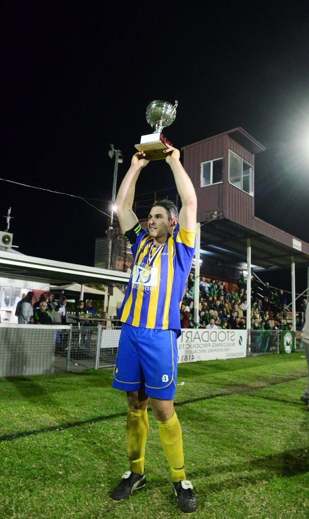 ON A ROLL: Across The Waves captain Matthew Martin holds the premiership cup aloft after beating Moore Park 4-0 at the grand final. Photo: Ben Turnbull / NewsMail