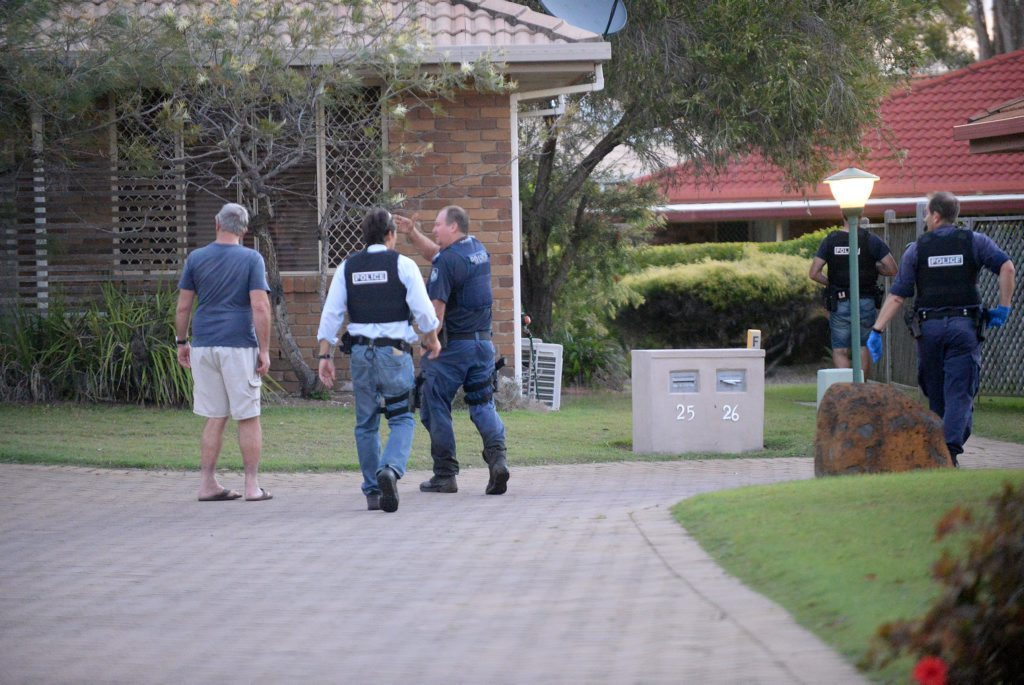 POLICE SEARCH: Armed policeman search residential property on Waimarie St Bargara. Photo: Mike Knott / NewsMail