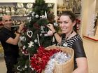 Myer staff members Michael Bou-Samra and Rachel Stoodley help to set the Christmas display in the Toowoomba store.