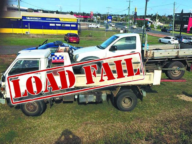There is just so much not to like about the way the way this Holden Rodeo ute has been tied onto the back of a Toyota Dyna Tipper for a trip down the Pacific Highway.
