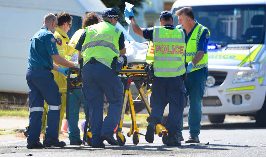 HELPING HANDS: Emergency Services crews help a patient.