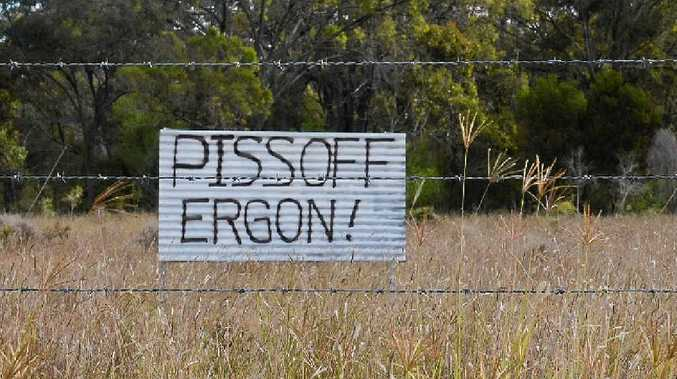 IT'S OVER: The dispute between Ergon Energy and Warwick residents (one of which erected this sign back in June) has ended after the 110kv Warwick-Stanthorpe powerline was scrapped.
