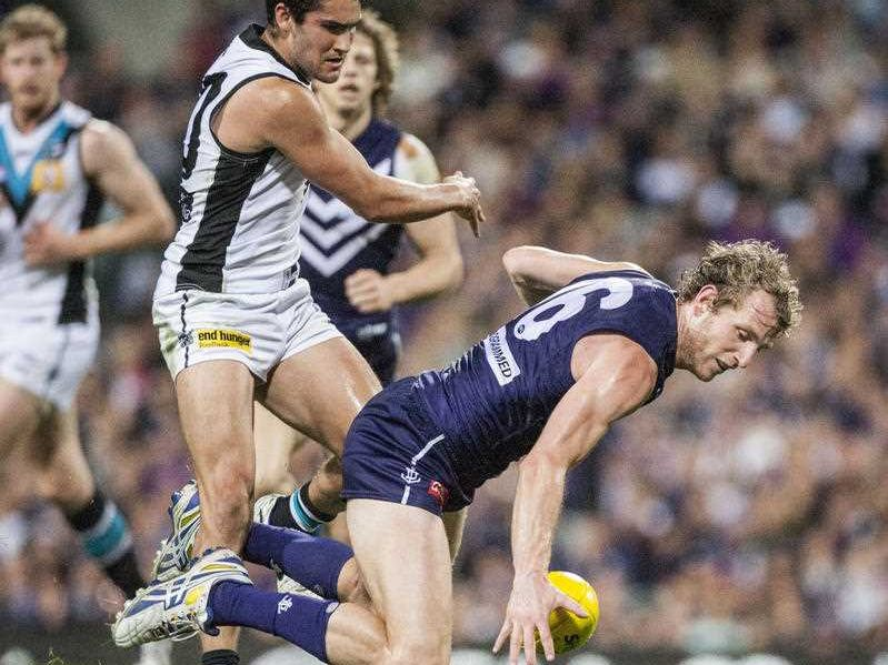 Chad Wingard of Port Adelaide and David Mundy of the Fremantle Dockers during the finals AFL match between the the Fremantle Dockers and the Adelaide's Port Power at Patersons Stadium in Perth, Sept 13, 2014. Port Power won the match 105-83.