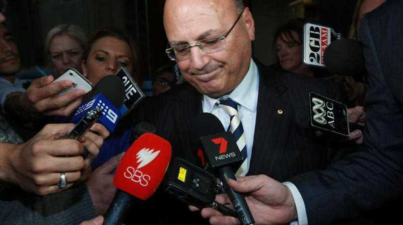 Senator Arthur Sinodinos departs after giving evidence at the Independent Commission Against Corruption (ICAC) hearing in Sydney, Friday, Sept. 12, 2014. The current ICAC investigation, Operation Spicer, is investigating illegal political donations used to bankroll the NSW Liberal Party's 2011 state election campaign.