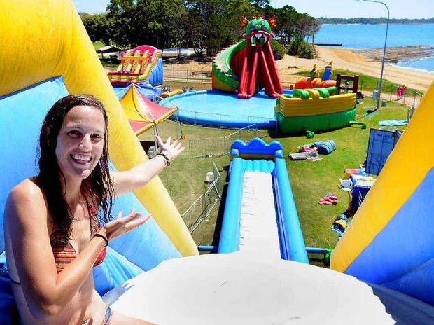 Alicia Klein sits at the top of the Dino Slide where she gets a great view before taking the plunge.