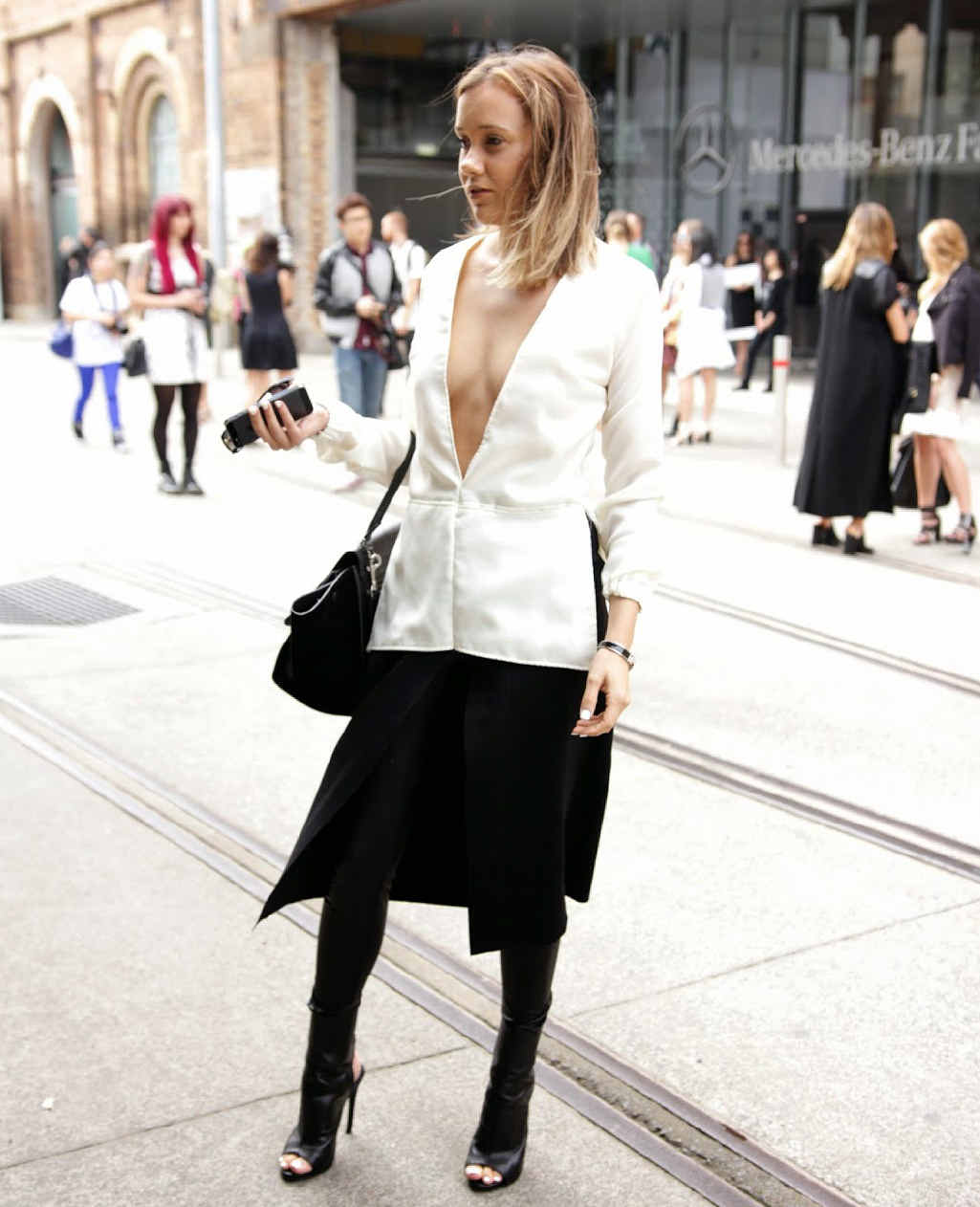 FREESTYLE FASHIONISTA: Gabby poses in the same outfit that was featured on Elle Australia. Inset: Gabby takes a quick snap at Mercedes-Benz Fashion Week Australia.