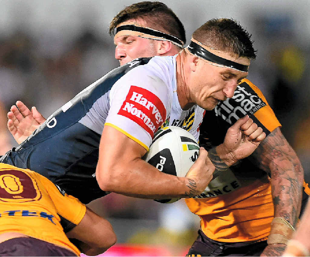 SIMS' SINS: Cowboy Tariq Sims is tackled by the Brisbane Broncos defence at 1300SMILES Stadium on Saturday. Sims has been hit with a grade-three charge for a shoulder charge on Justin Hodges during the match.