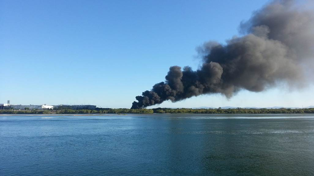Thick smoke billows from a fire near the Pioneer River in this photo by Mackay Weather Chasers.