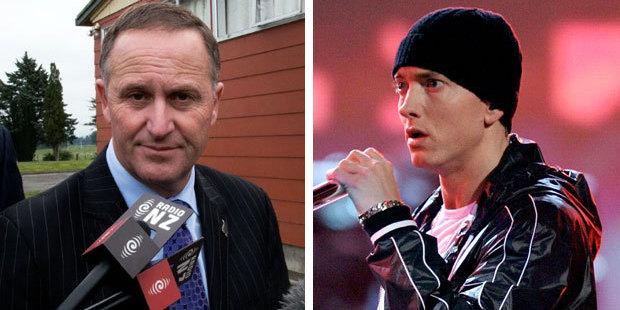 Prime Minister John Key and rapper Eminem. Photo / AFP; Getty Images