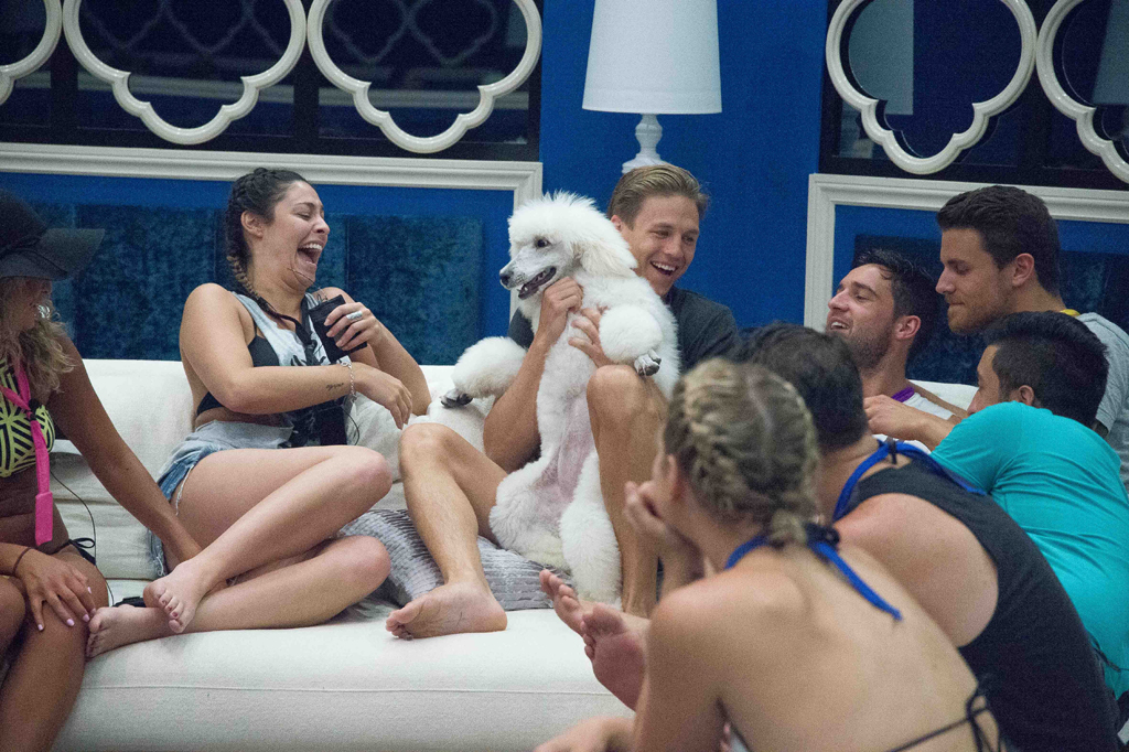 Ryan and the other housemates welcome poodle Kelly.