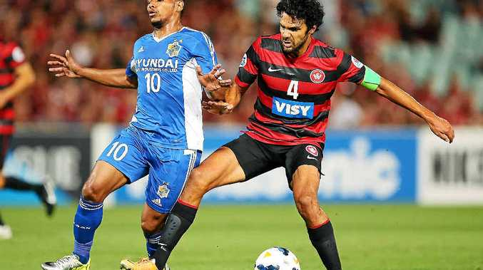ROCK SOLID: Wanderers defender Nikolai Topor-Stanley in action against Ulsan Hyundai in the Asian Champions League earlier this year.