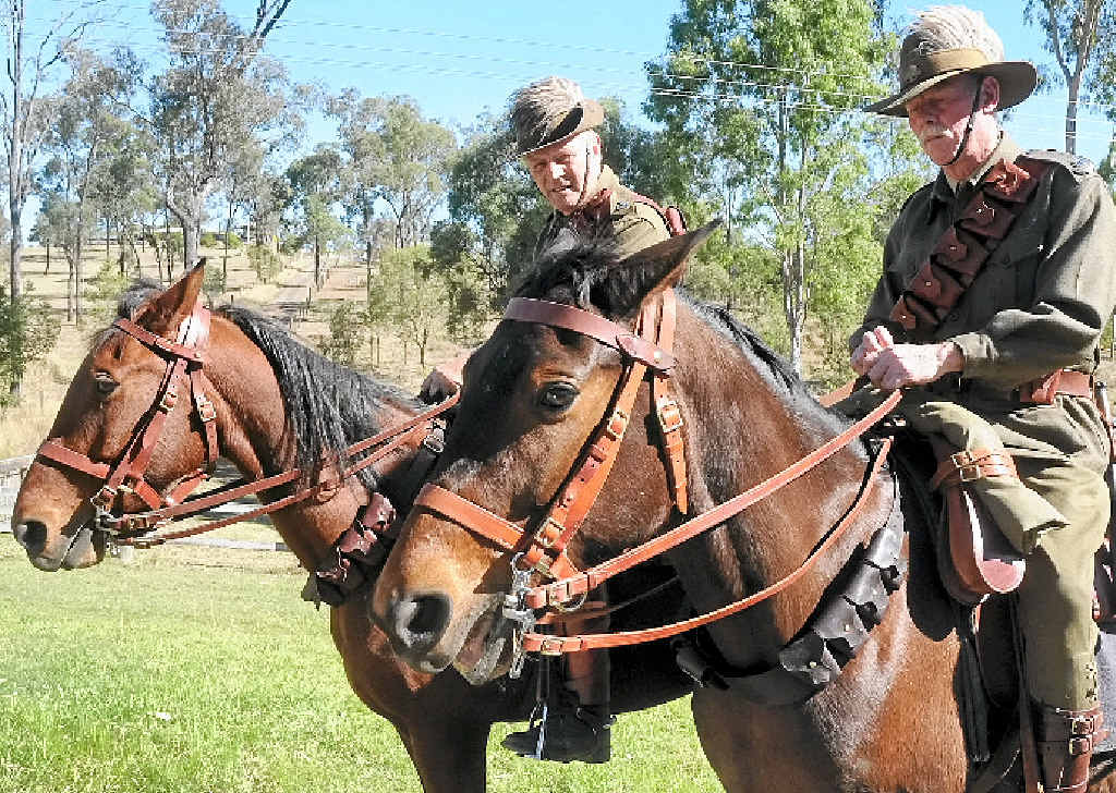 SADDLED UP: Jack Canning and Stewart Cook look forward to the Light Horse centenary march later this month.