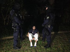 Man arrested following the execution of search warrants across Sydney's north-west suburbs, Thursday, Sept. 18, 2014. Authorities have raided a string of homes and made several arrests as part of counter-terrorism operation in Sydney.