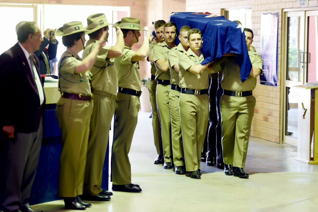 The coffin of Thomas Henry 'Buddy' Lea being carried into the Hervey Bay Baptist Church in Nikenbah.