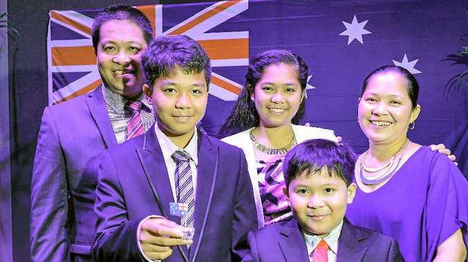 NEW ERA: The Villarico family became citizens at the Citizenship Day ceremony. Pictured are Dante, Juan Casimiro, 12, Maria Daniella, 15, Johan Gabriel, 9, and Aida Villarico.