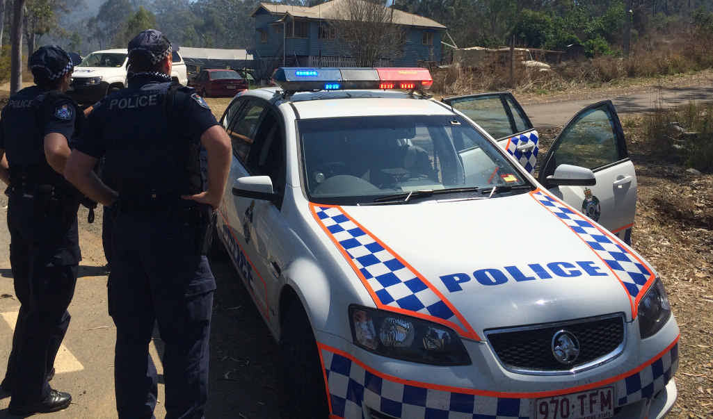 DRAMATIC: Police set up a road block near Mt Morgan as they search for the gunman.