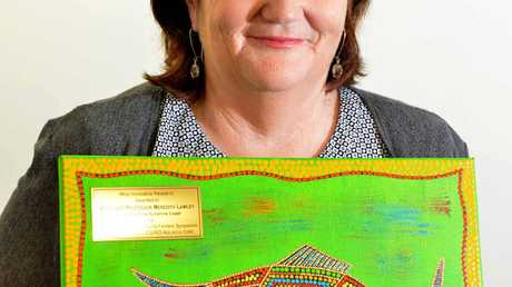 FOOD FOR THOUGHT: University of the Sunshine Coast academic Dr Meredith Lawley shows off her award for innovative research into the Australian farmed barramundi industry.