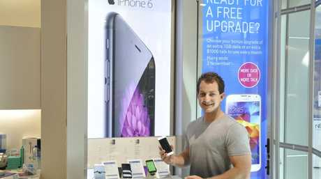 Ben Walker with the new iPhone 6.