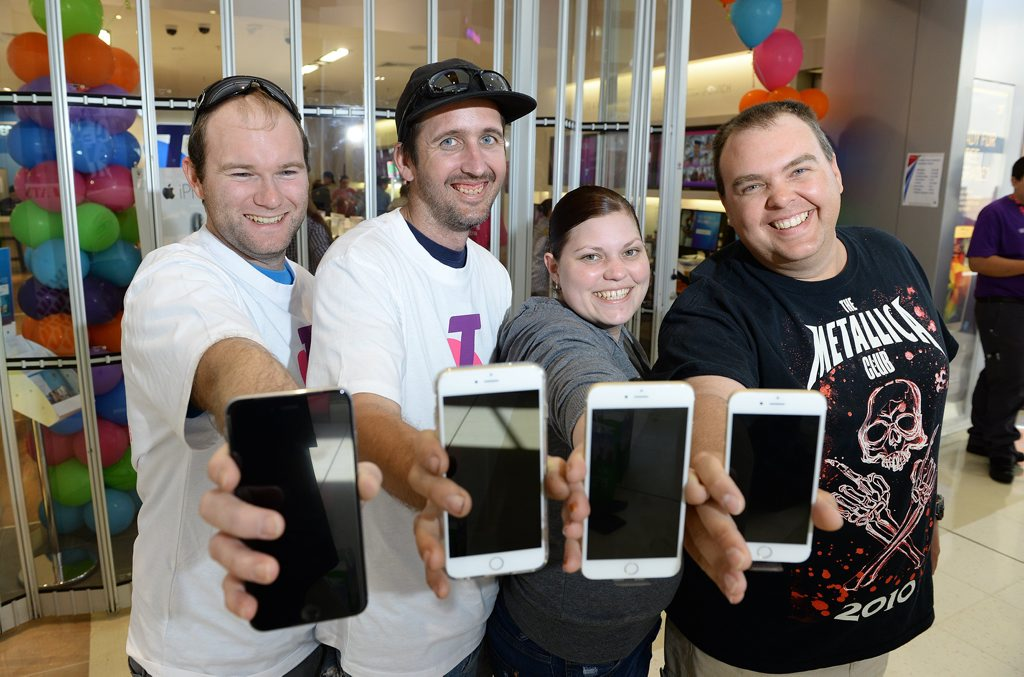 Happy about their new phone purchases are Dan Edbrook, Peter Caswell, Kim Allwood and Lance Ballard.