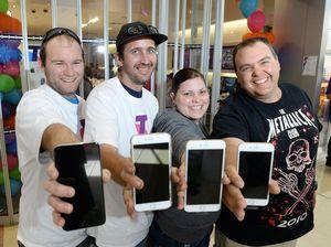 Apple devotees line up for flash new model