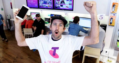 FIRST IN: Peter Caswell celebrates being the first customer to get his hands on a new iPhone 6 at the Riverlink Telstra store.